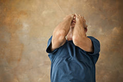 Worried mature man touching his head. Stock Photography