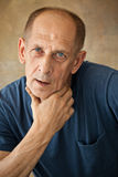 Worried mature man touching his head. Stock Images