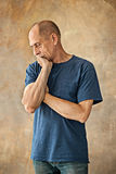 Worried mature man touching his head. Royalty Free Stock Image