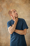 Worried mature man touching his head. Stock Photos