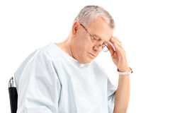 Worried mature patient looking down Royalty Free Stock Photo