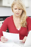 Worried Mature Woman Looking Reviewing Finances At Home Royalty Free Stock Photography