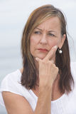Worried mature woman portrait outdoor Royalty Free Stock Images