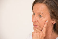 Worried mature woman thinking portrait stock photo