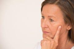 Worried mature woman thinking portrait Stock Photo