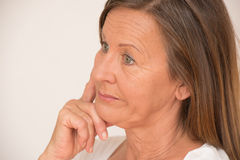 Worried mature woman thinking Stock Images