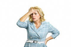Worried mature woman touching head. Depressed white-skin businesswoman touching her face on white background. Stressed busineswoman with headache, migraine or Royalty Free Stock Photography