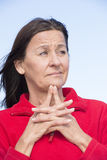 Worried mature woman wrinkled forehead Stock Image