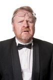 Worried middle aged man in tuxedo on white Royalty Free Stock Images