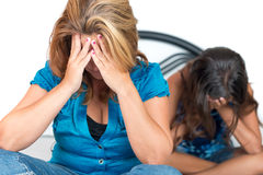 Worried mMother and teenage daughter crying Royalty Free Stock Photo