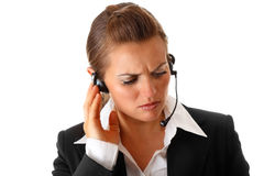 Worried modern business woman with headset Royalty Free Stock Images