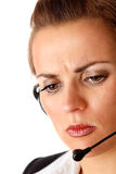 Worried modern business woman with headset Stock Photo