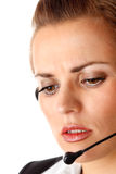 Worried modern business woman with headset Stock Image