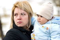 Worried mother with baby Royalty Free Stock Photos