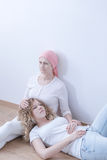 Worried cancer mother with daughter. Worried mother battling malignant cancer spending time with daughter Royalty Free Stock Photo