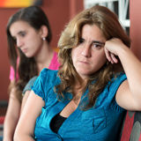 Worried mother and her sad teenage daughter Stock Photo