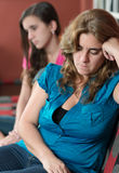 Worried mother and her sad teenage daughter Stock Images