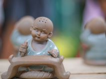 Worried novice statue in close-up shoot. This is a collection of littile novice statues in different emotions. In real situation, it just has 5cm in tall but royalty free stock image
