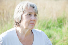 Worried old age woman Royalty Free Stock Image