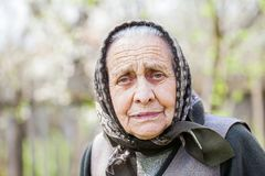 Worried old lady with headscarf Stock Photo