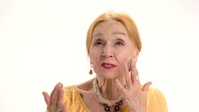 Worried old lady. Woman talking on white background. The honest story stock video