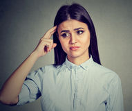 Worried pensive young woman thinking royalty free stock photography