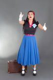 Worried pinup girl with suitcase Stock Photography