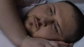 Worried plump man trying to fall asleep, health disorder, depression, loneliness. Stock footage stock footage