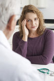 Worried Plus Size Woman Meeting With Doctor In Surgery Royalty Free Stock Photo