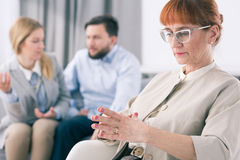 Worried psychologist and fighting couple Royalty Free Stock Photography