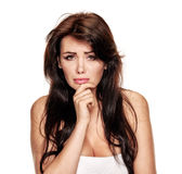 Worried sad beauty woman. Young sad worried woman biting her finger Stock Photography