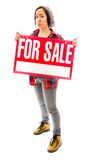 Worried saleswoman showing a for sale sign Stock Photography