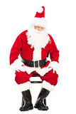 Worried Santa Claus sitting on a chair Royalty Free Stock Images