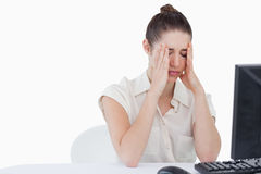 Worried secretary using a computer Stock Images
