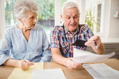 Worried senior couple checking their bills Royalty Free Stock Photos