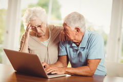 Worried senior couple using laptop Royalty Free Stock Image