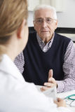 Worried Senior Man Meeting With Doctor In Surgery Royalty Free Stock Image
