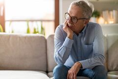 Free Worried Senior Man Sitting Alone In His Home Stock Photos - 175375153