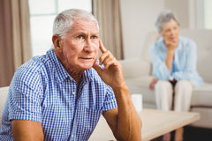 Worried senior man sitting on sofa Stock Photography