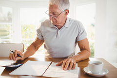 Worried senior man with tax documents Stock Image
