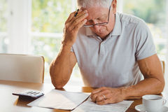 Worried senior man with tax documents Stock Photos