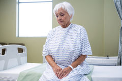 Worried senior patient sitting on bed royalty free stock image