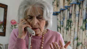 Worried Senior Woman Answering Telephone At Home stock video
