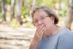 Worried Senior Woman Sitting Alone Royalty Free Stock Photography