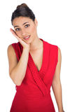 Worried sexy brunette in red dress posing Royalty Free Stock Photo