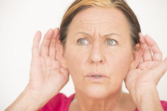 Worried shocked woman listening Royalty Free Stock Photos
