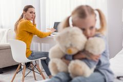 Worried single mom having problem with daughter stock photos