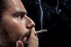 Worried and smoking Royalty Free Stock Photography