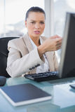 Worried sophisticated businesswoman working on computer. In bright office royalty free stock photography