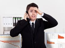 Worried stock broker on the phone Royalty Free Stock Photography